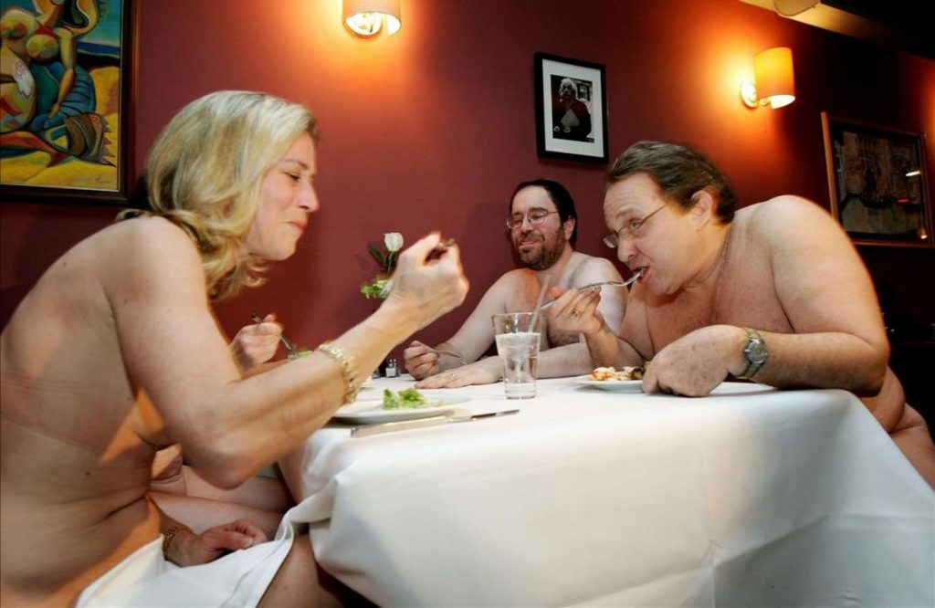 A group of nudists eat together at a  Clothing Optional Dinner  at a New York City restaurant  February 17  2005  The diners arrived on a cold Thursday night looking remarkably respectable and stripped off scarves  hats and coats  They didn t stop there  Sweaters  shirts  skirts  pants  underwear all end up stashed in a plastic bag by the bar  This is the monthly  Clothing Optional Dinner  for a group of nudists who wanted something a bit more elegant than the wilderness getaways and beach resorts they generally frequent  Around 30 people arrived for the buffet dinner -- no hot soup on the menu -- most of them middle-aged  several married couples  some singles  the youngest perhaps in their 30s  Health regulations mean staff must remain clothed even if they wanted to join in  And diners must bring something to sit on -- a towel or  for discerning women  an elegant silk scarf      FOR RELEASE WITH STORY LIFE-NAKED     REUTERS Mike Segar